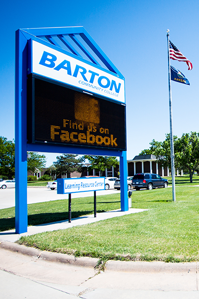 Barton welcome sign with flag
