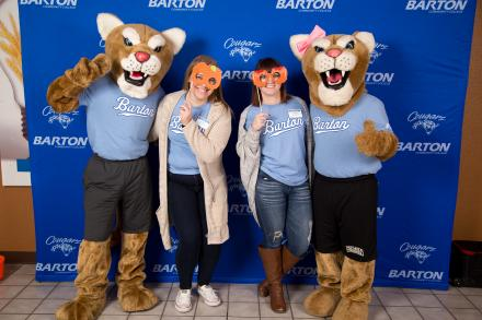 Mascots posing with students